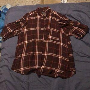 A long sleeved plaid shirt